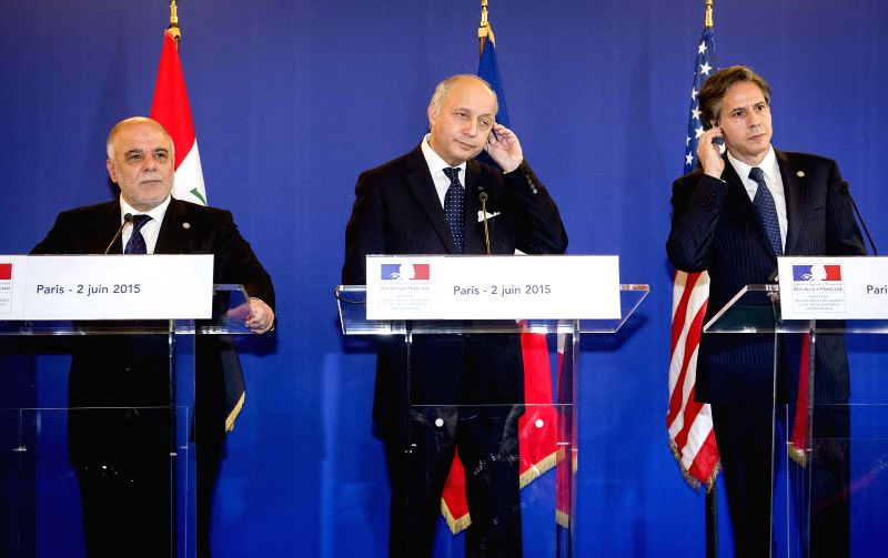 French Foreign Minister Laurent Fabius (C) attends a joint press meeting with Iraqi Prime Minister Haider al-Abadi (L) and U.S. Deputy Secretary of State Antony ... - Laurent Fabius