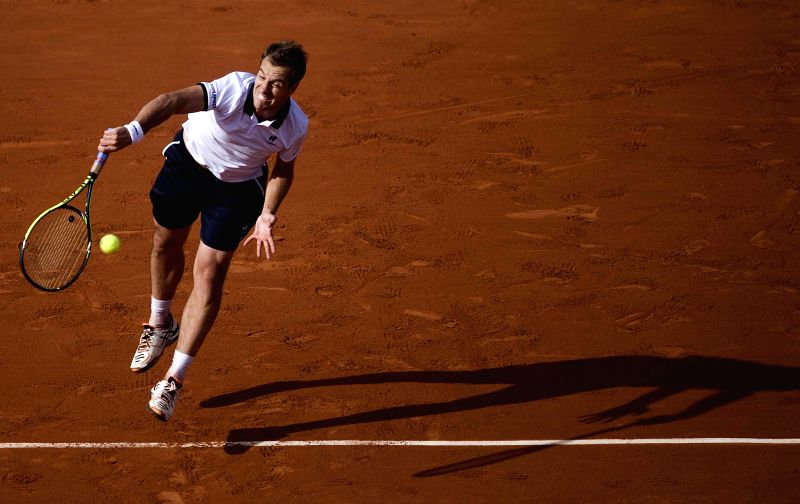 Serbia's Novak Djokovic serves to France's Richard Gasquet during the men's singles fourth round match at the 2015 French Open tennis tournament at Roland Garros in ...