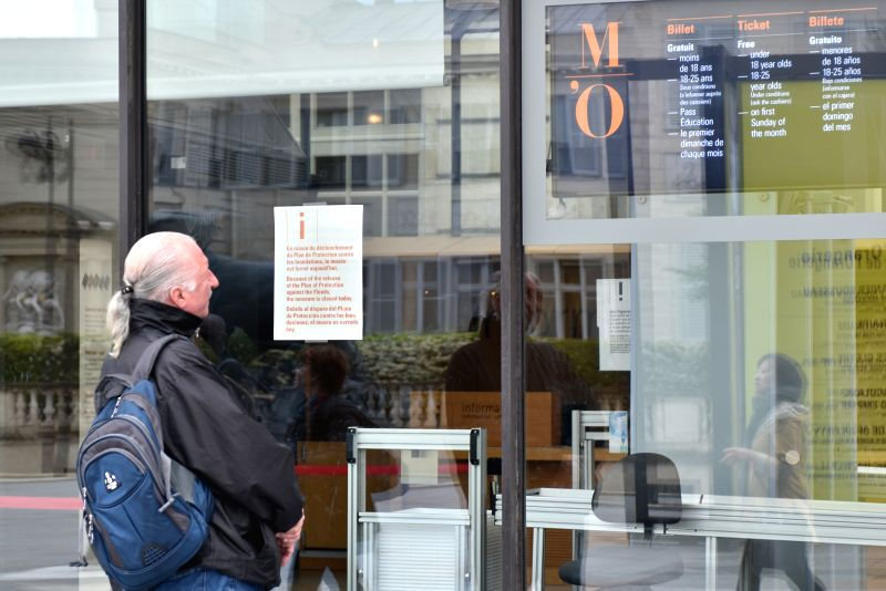 PARIS, June 3, 2016 - A man reads the closing notices of the Orsay Museum in Paris, France, June 3, 2016. On high risks of floods, Le Louvre Museum closed its doors earlier than scheduled and would ...