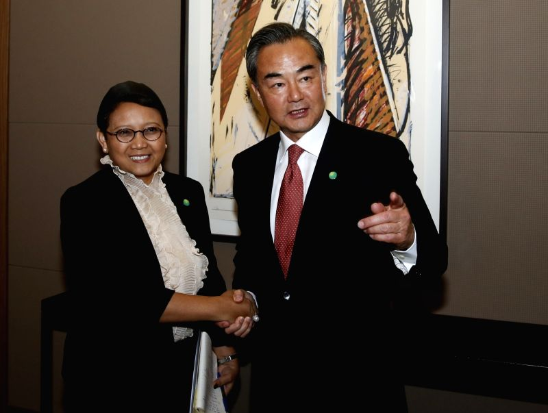 PARIS, June 3, 2016 - Chinese Foreign Minister Wang Yi (R) meets with Indonesian Foreign Minister Retno Marsudi in Paris, capital of France, on June 3, 2016. - Wang Y