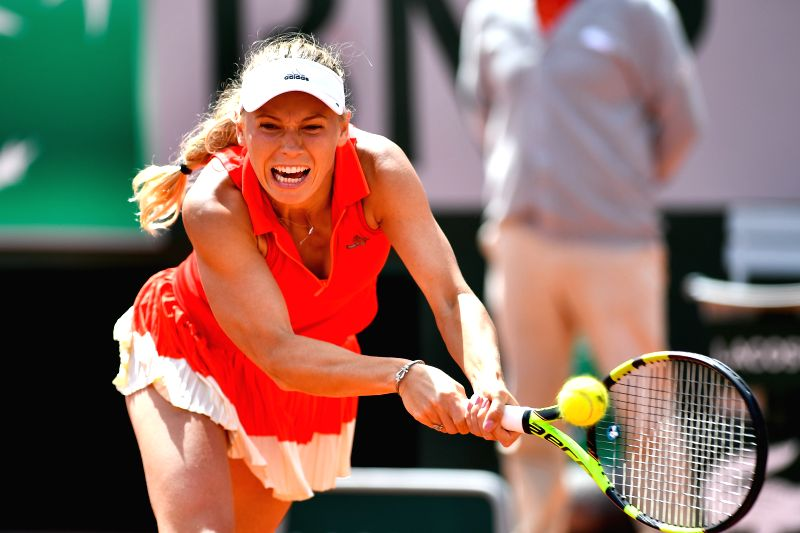 PARIS, June 4, 2017 - Caroline Wozniacki of Denmark returns the ball to Svetlana Kuznetsova of Russia during the women's singles round of 16 match at the French Open Tennis Tournament 2017 in Paris, ...