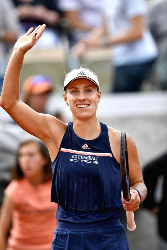 PARIS, June 4, 2018 - Angelique Kerber of Germany greets the spectators after winning the women's singles 4th round match against Caroline Garcia of France at the French Open Tennis Tournament 2018 ...(Image Source: Xinhua/Chen Yichen/IANS)