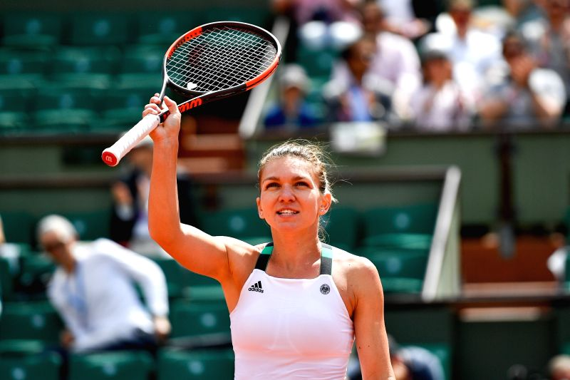 PARIS, June 5, 2017 - Simona Halep of Romania celebrates after the women's singles fourth round match against Carla Suarez Navarro of Spain at the French Open Tennis Tournament 2017 in Paris, France, ...