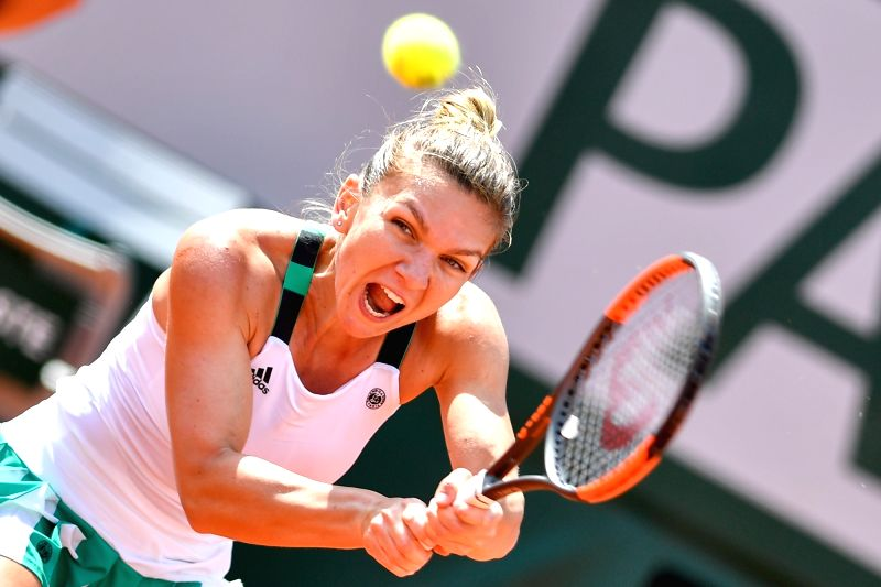 PARIS, June 5, 2017 - Simona Halep of Romania returns the ball to Carla Suarez Navarro of Spain during the women's singles fourth round match at the French Open Tennis Tournament 2017 in Paris, ...