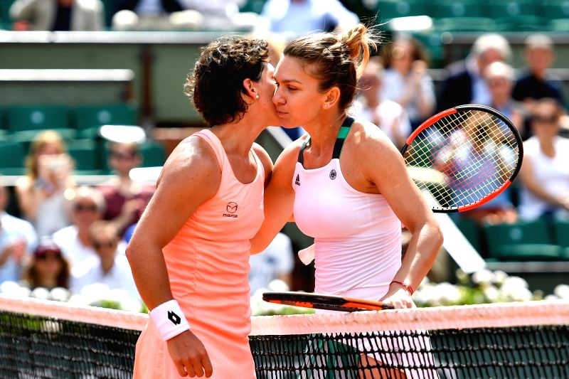 PARIS, June 5, 2017 - Simona Halep(R) of Romania and Carla Suarez Navarro of Spain greet each other after their women's singles fourth round match at the French Open Tennis Tournament 2017 in Paris, ...