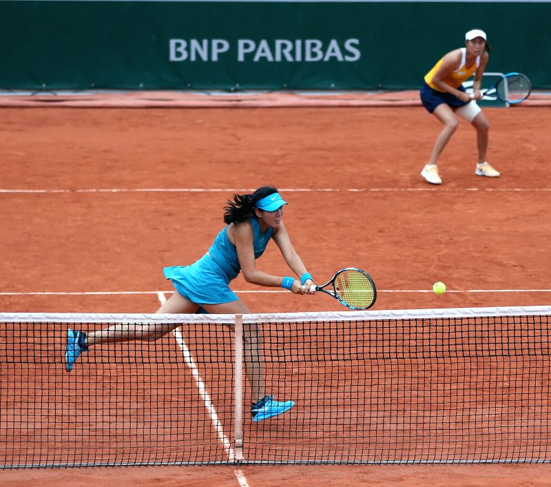 PARIS, June 5, 2018 - Chan Hao-Ching of Chinese Taipei and Yang Zhaoxuan (L) of China compete during the women's doubles quarterfinal match against Irina Bara/Mihaela Buzarnescu of Romania at the ...