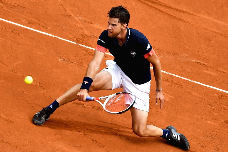 PARIS, June 5, 2018 - Dominic Thiem of Austria returns a shot during the men's singles quarterfinal match against Alexander Zverev of Germany at the French Open Tennis Tournament 2018 in Paris, ...