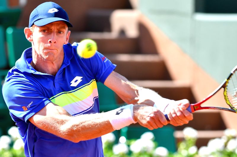 PARIS, June 6, 2017 - Kevin Anderson of South Africa returns the ball to Marin Cilic of Croatia during the men's singles round of 16 match at the French Open Tennis Tournament 2017 in Paris, France ...