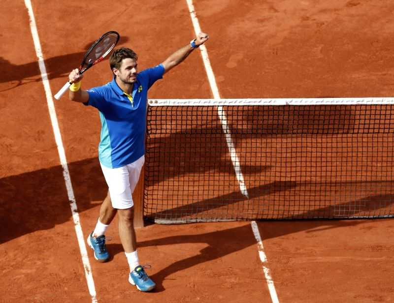 PARIS, June 6, 2017 - Stan Wawrinka of Switzerland celebrates after winning the men's singles round of 16 match with Gael Monfils of France at French Open Tennis Tournament 2017 in Roland Garros, ...