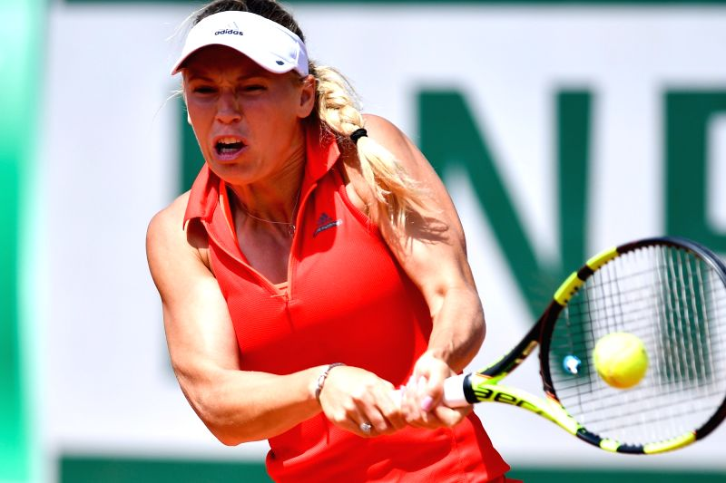 PARIS, June 7, 2017 - Caroline Wozniacki of Denmark returns the ball during the women's singles quarterfinal against Jelena Ostapenko of Latvia at the 2017 French Open Tennis Tournament in Paris, ...
