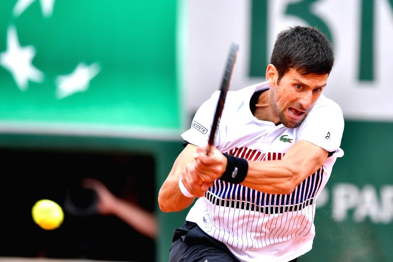 PARIS, June 7, 2017 - Novak Djokovic of Serbia hits a return during the men's quarterfinal match against Dominic Thiem of Austria at the French Open Tennis Tournament 2017 in Paris, France, on June ...
