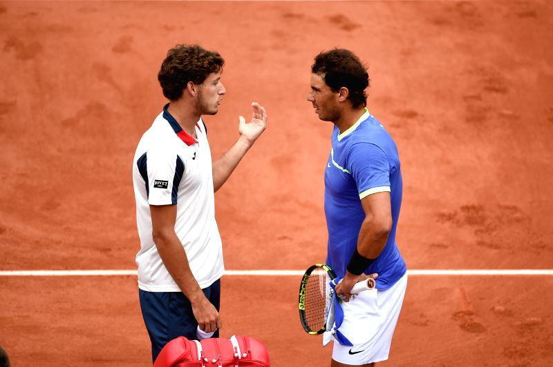 PARIS, June 7, 2017 - Rafael Nadal (R) of Spain talks with his compatriot Pablo Carreno Busta after the men's quarterfinal at the French Open Tennis Tournament 2017 in Paris, France on June 7, 2017. ...