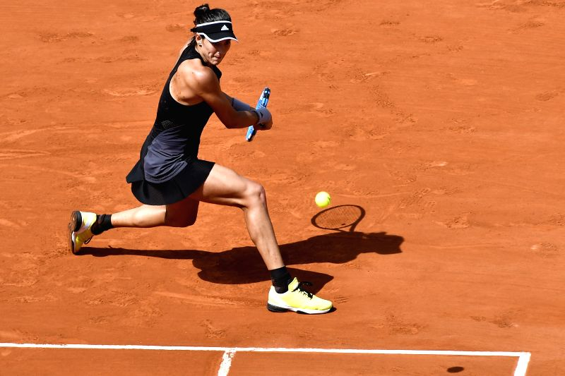 PARIS, June 7, 2018 - Garbine Muguruza of Spain hits a return during the women's singles semifinal match against Simona Halep of Romania at the French Open Tennis Tournament 2018 in Paris, France on ...