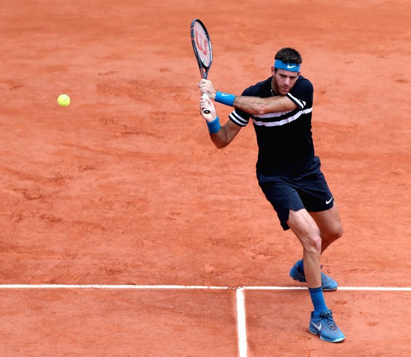 PARIS, June 7, 2018 - Juan Martin Del Potro of Argentina returns the shot during the men's singles quarterfinal match against Marin Cilic of Croatia at the French Open Tennis Tournament 2018 in ...