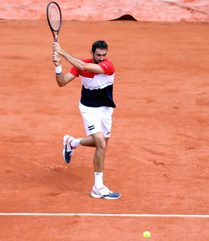 PARIS, June 7, 2018 - Marin Cilic of Croatia returns the shot during the men's singles quarterfinal match against Juan Martin Del Potro of Argentina at the French Open Tennis Tournament 2018 in ...