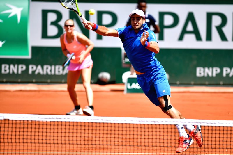 PARIS, June 8, 2017 - Anna-Lena Groenefeld (L) of Germany and Robert Farah of Colombia compete during the mixed doubles final match against Gabriela Dabrowski of Canada and Rohan Bopanna of India at ... - Rohan Bopanna