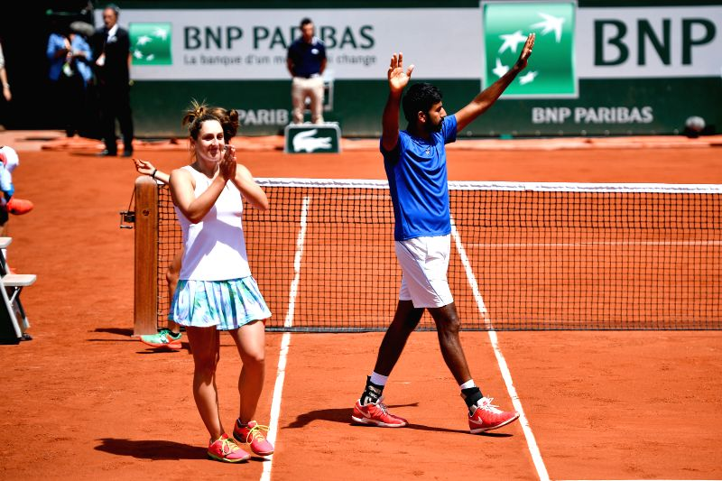 PARIS, June 8, 2017 - Gabriela Dabrowski (L) of Canada and Rohan Bopanna of India celebrate after the mixed doubles final match against Anna-Lena Groenefeld of Germany and Robert Farah of Colombia at ... - Rohan Bopanna