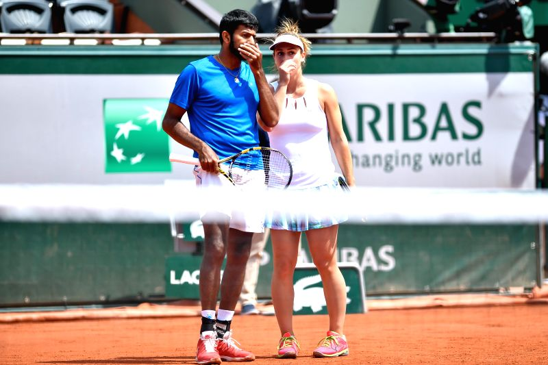 PARIS, June 8, 2017 - Gabriela Dabrowski (R) of Canada and Rohan Bopanna of India talk during the mixed doubles final match against Anna-Lena Groenefeld of Germany and Robert Farah of Colombia at the ... - Rohan Bopanna