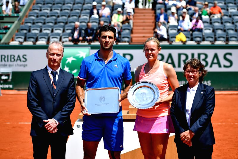 PARIS, June 8, 2017 - Robert Farah (2nd L) of Colombia and Anna-Lena Groenefeld (2nd R) of Germany pose during the awarding ceremony after the mixed doubles final match against Gabriela Dabrowski of ... - Rohan Bopanna
