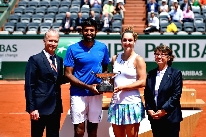 PARIS, June 8, 2017 - Rohan Bopanna (2nd L) of India and Gabriela Dabrowski (2nd R) of Canada pose during the awarding ceremony after the mixed doubles final match against Anna-Lena Groenefeld of ... - Rohan Bopanna