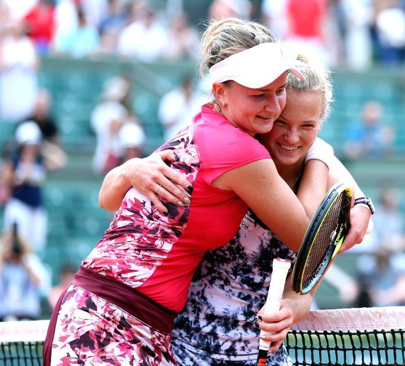 PARIS, June 8, 2018 - Barbora Krejcikova (L) and Katerina Siniakova of the Czech Republic celebrate victory after winning the women's doubles final against Eri Hozumi and Makoto Ninomiya of Japan at ...