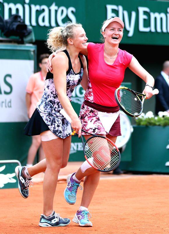 PARIS, June 8, 2018 - Barbora Krejcikova (R) and Katerina Siniakova of the Czech Republic celebrate victory after winning the women's doubles final against Eri Hozumi and Makoto Ninomiya of Japan at ...