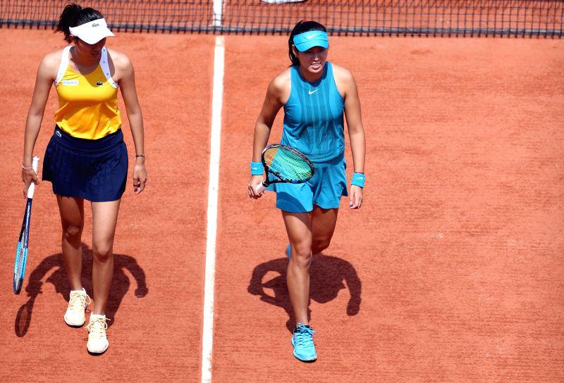 PARIS, June 8, 2018 - Chan Hao-Ching (L) of Chinese Taipei and Yang Zhaoxuan of China react during the women's doubles semifinal match against Eri Hozumi and Makoto Ninomiya of Japan at the French ...