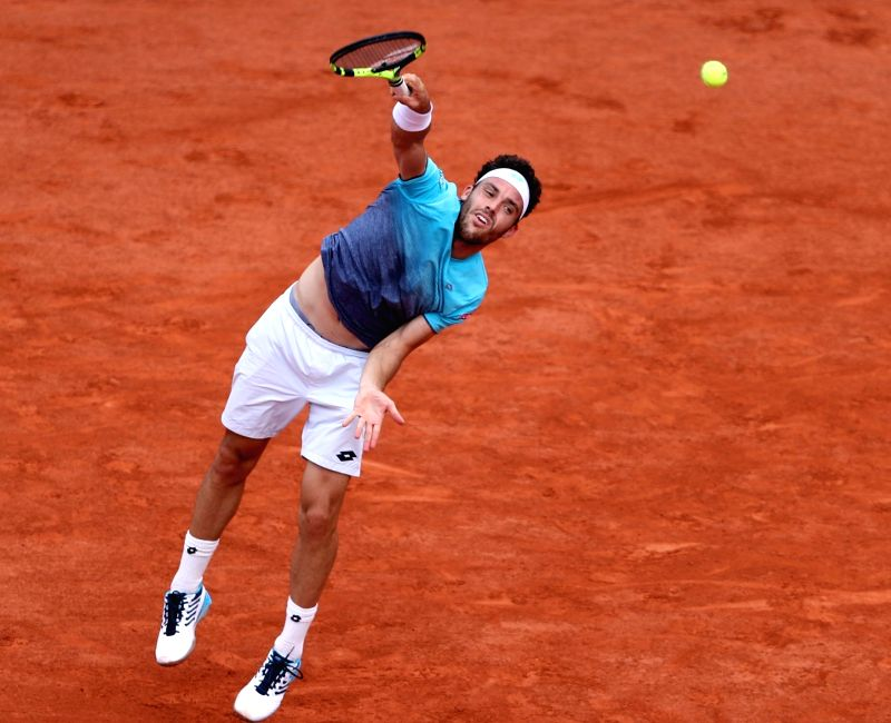PARIS, June 8, 2018 - Marco Cecchinato of Italy serves during the men's singles semifinal match against Dominic Thiem of Austria at the French Open Tennis Tournament 2018 in Paris, France on June 8, ...