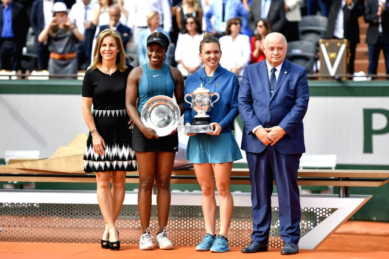PARIS, June 9, 2018 - Simona Halep (2nd R) of Romania and Sloane Stephens (2nd L) of the United States pose during the awarding ceremony after the women's singles final at the French Open Tennis ...