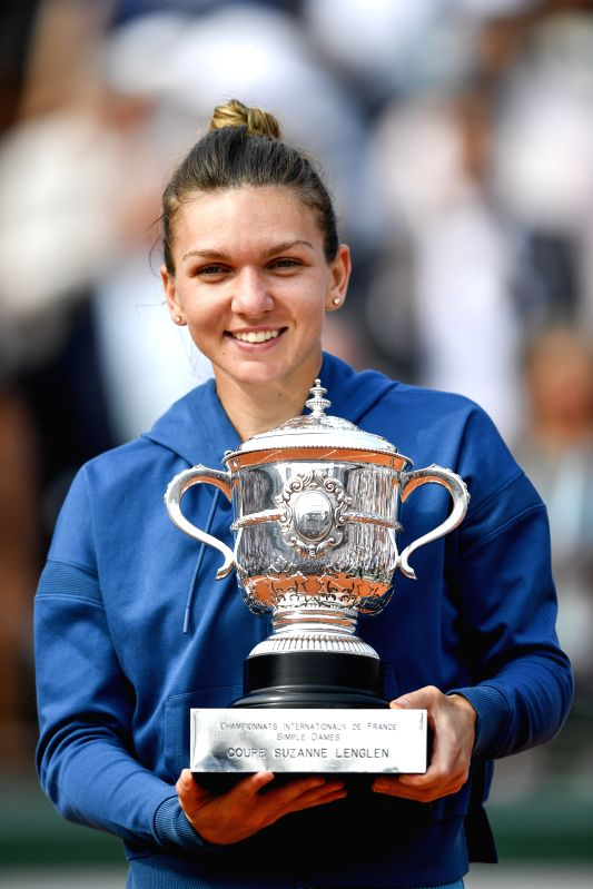 PARIS, June 9, 2018 - Simona Halep of Romania poses with the trophy during the awarding ceremony after the women's singles final against Sloane Stephens of the United States at the French Open Tennis ...