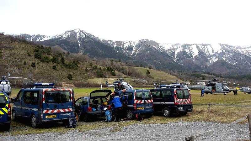 Rescue team members gather in a field where rescue efforts are headquartered near Seyne-les-Alpes, France, on March 24, 2015. Interior Minister Bernard Cazeneuve ... - Bernard Cazeneuve