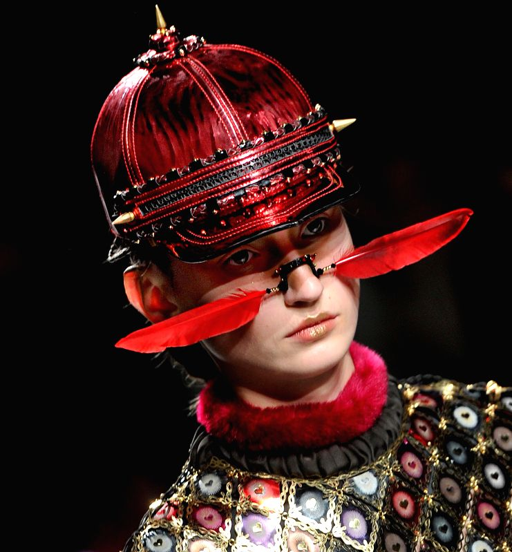 A model presents a creation by Indian designer Manish Arora during Paris Fashion Week in Paris, France, on March 5, 2015.