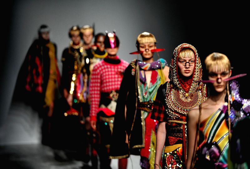 Models present creations by Indian designer Manish Arora during Paris Fashion Week in Paris, France, on March 5, 2015.