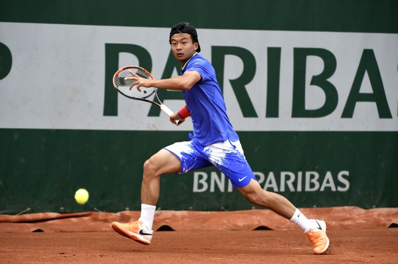 PARIS, May 22, 2017 - Chinese player Wu Di returns the ball to Belarusian player Uladzimir Ignatik during the 1st round of the qualification of the French Open in Paris, France on May 22, 2017. Wu Di ...