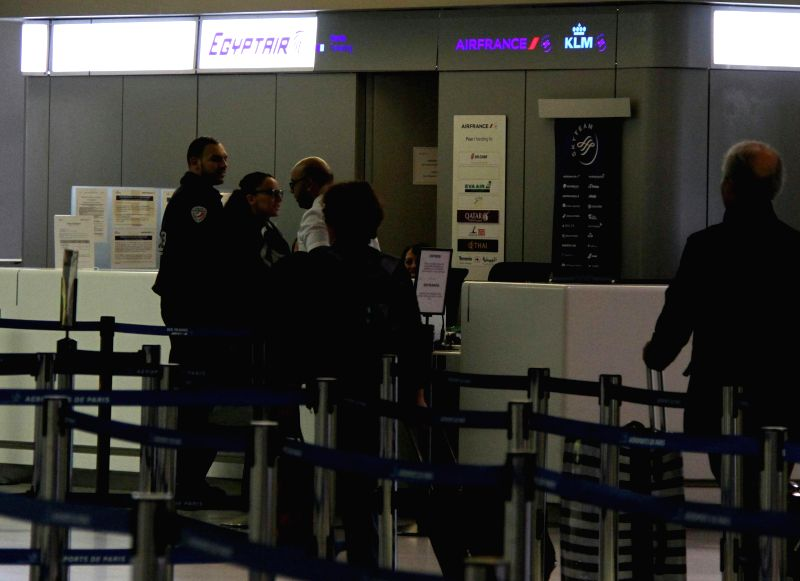 PARIS, May 24, 2016 - Workers and police officers stand in front of EgyptAir's counter at the Charles de Gaulle Airport, in Paris, France, May 23, 2016. The airport beefed up its security measures ...