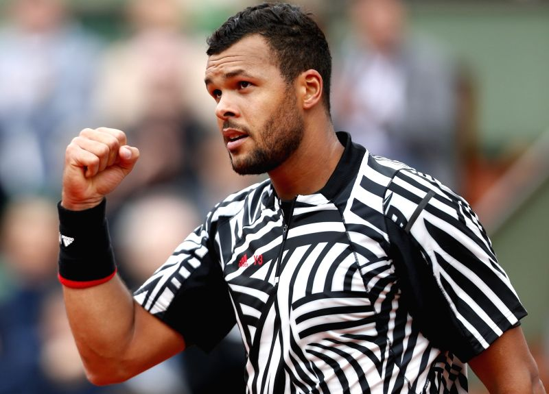 PARIS, May 25, 2016 - Jo-Wilfried Tsonga of France returns the ball during the men's singles first round match against Jan-Lennard Struff of Germany at the French Open tennis tournament at Roland ...