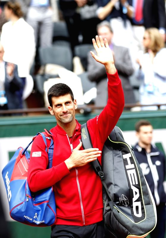 PARIS, May 25, 2016 - Novak Djokovic of Serbia reacts after the men's singles first round match against Yen-Hsun Lu of Chinese Taipei on day 3 of 2016 French Open tennis tournament at Roland Garros, ...