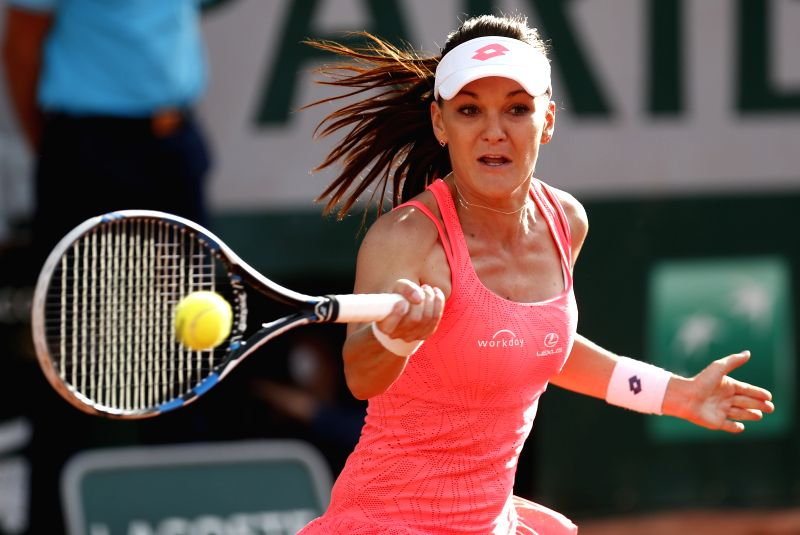PARIS, May 26, 2016 - Agnieszka Radwanska of Poland returns the ball during the women's singles second round match against Caroline Garcia of France on day 4 of 2016 French Open tennis tournament at ...
