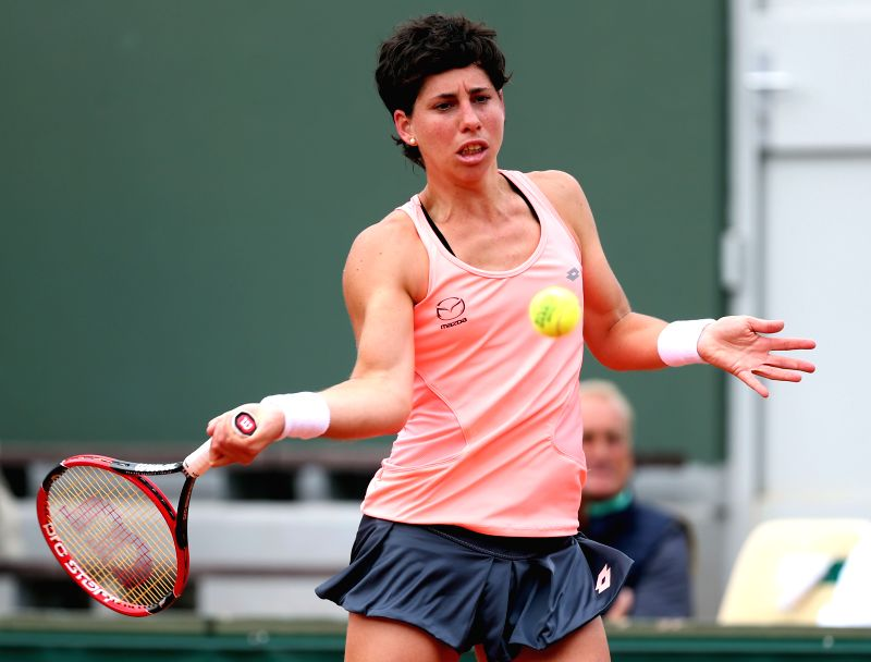PARIS, May 26, 2016 - Carla Suarez Navarro of Spain competes during the women's singles second round match against Wang Qiang of China on day 5 of 2016 French Open tennis tournament at Roland Garros ...