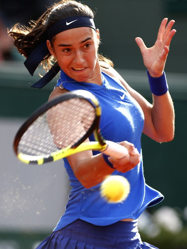 PARIS, May 26, 2016 - Caroline Garcia of France returns the ball during the women's singles second round match against Agnieszka Radwanska of Poland on day 4 of 2016 French Open tennis tournament at ...