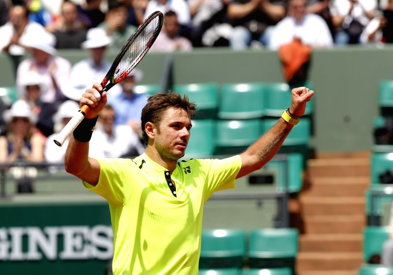 PARIS, May 26, 2016 - Stan Wawrinka of Switzerland celebrates after the men's singles second round match against Taro Daniel of Japan  on day 4 of 2016 French Open tennis tournament at Roland Garros, ...