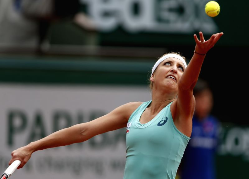 PARIS, May 26, 2016 - Timea Bacsinszky of Switzerland serves the ball during the women's singles second round match against Eugenie Bouchard of Canada on day 5 of 2016 French Open tennis tournament ...