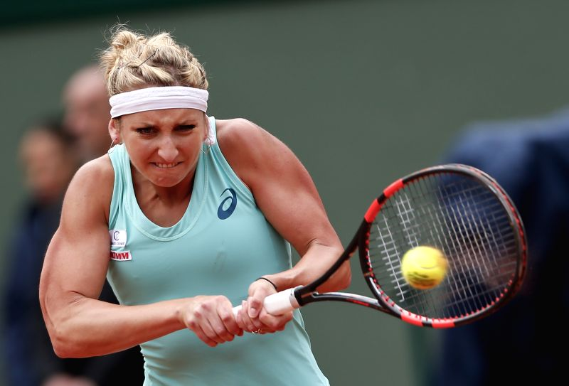 PARIS, May 26, 2016 - Timea Bacsinszky of Switzerland competes during the women's singles second round match against Eugenie Bouchard of Canada on day 5 of 2016 French Open tennis tournament at ...