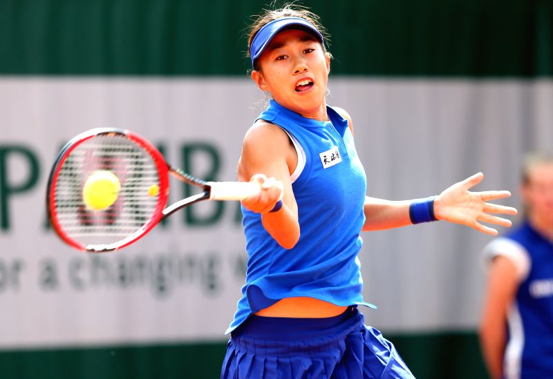 PARIS, May 26, 2016 - Zhang Shuai of China returns the ball during the women's singles second round match against Samantha Stosur of Australia on day 4 of 2016 French Open tennis tournament at Roland ...