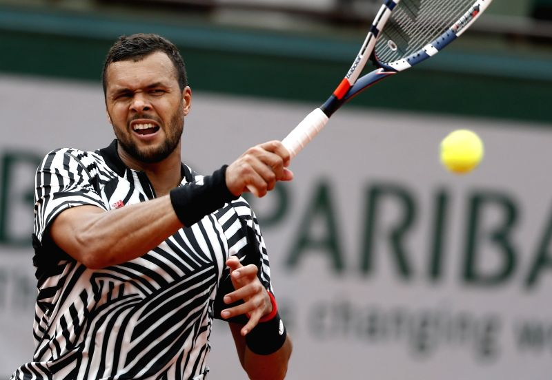 PARIS, May 27, 2016 - Jo-Wilfried Tsonga of France returns the ball during the men's singles second round match against Marcos Baghdatis of Cyprus on day 5 of 2016 French Open tennis tournament at ...
