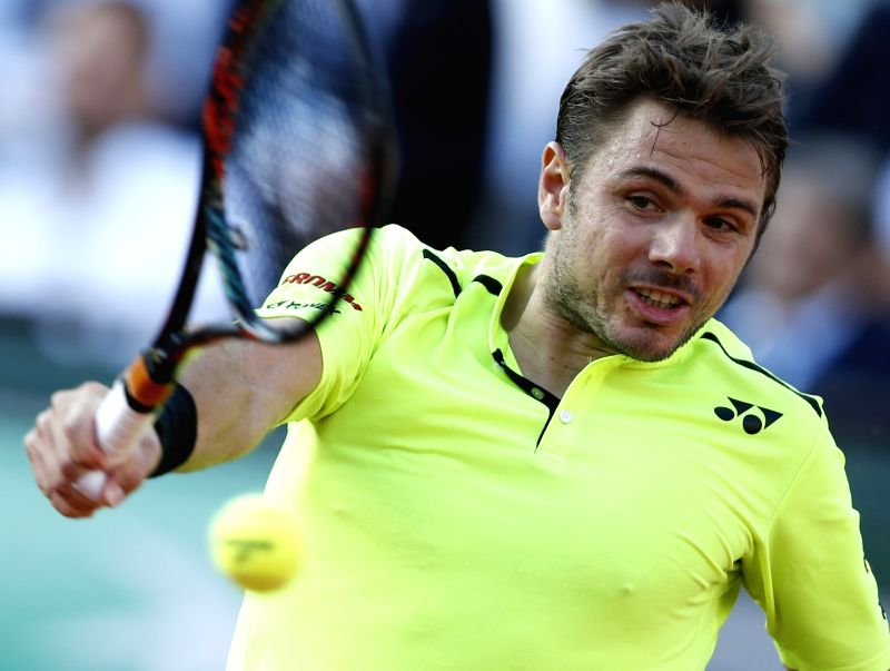 PARIS, May 28, 2016 - Stan Wawrinka of Switzerland returns a ball during the men's single third round match against Jeremy Chardy of France at the French Open tennis tournament at Roland Garros in ...