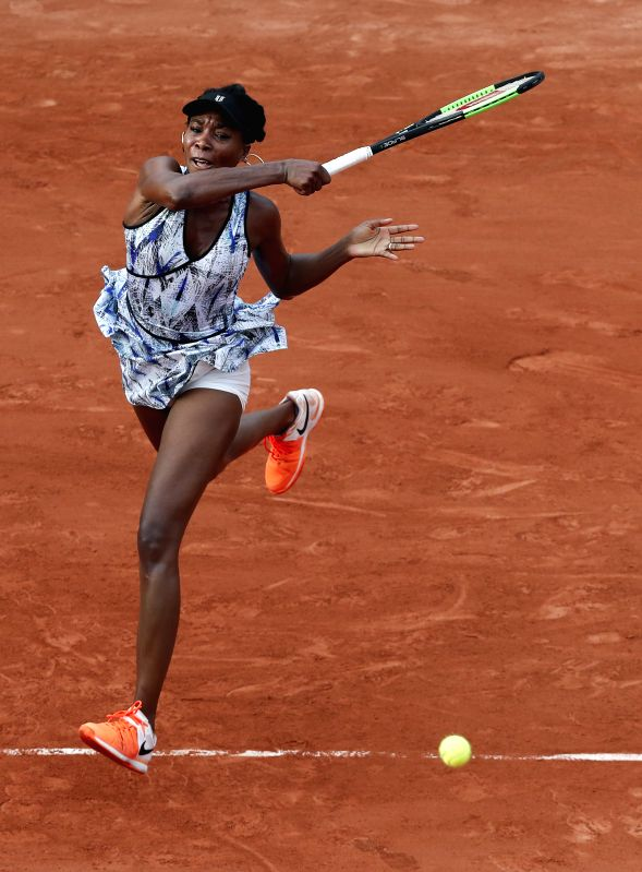 PARIS, May 29, 2017 - Venus Williams of the United States hits a return during the women's singles first round match against Wang Qiang of China at French Open Tennis Tournament 2017 in Roland ...