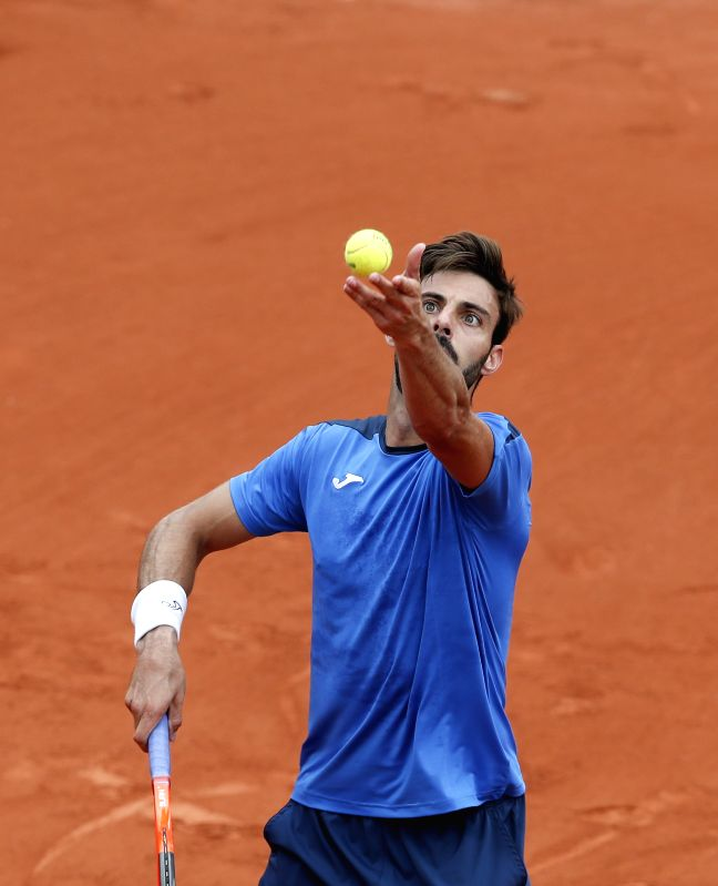 PARIS, May 30, 2017 - Marcel Granollers of Spain serves during the men's singles first round match against Novak Djokovic of Serbia at French Open Tennis Tournament 2017 in Roland Garros, Paris, ...