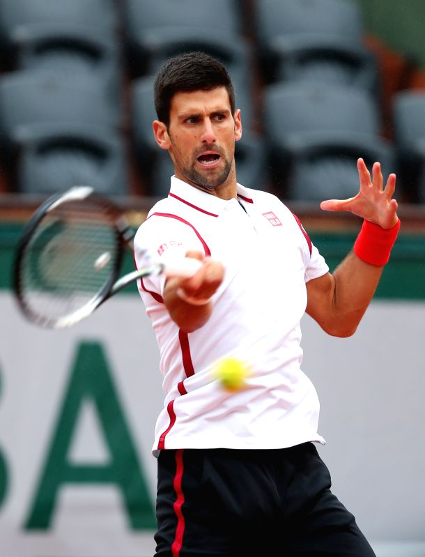 PARIS, May 31, 2016 - Novak Djokovic of Serbia returns the ball during the men's singles fourth round match with Roberto Bautista Agut of Spain at 2016 French Open tennis tournament at Roland Garros, ...