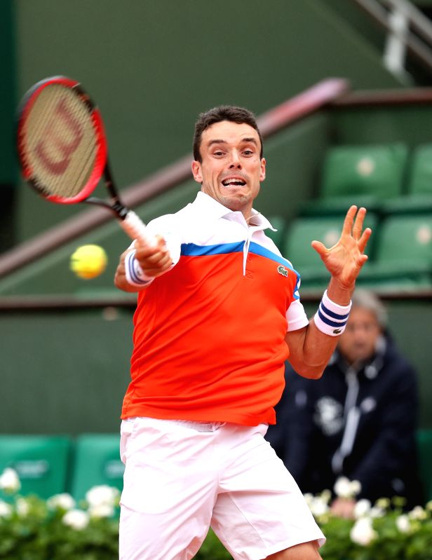 PARIS, May 31, 2016 - Roberto Bautista Agut of Spain returns the ball during the men's singles fourth round match with Novak Djokovic of Serbia at 2016 French Open tennis tournament at Roland Garros, ...